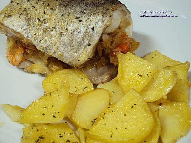 Pescadilla rellena al horno receta petitchef for Merluza rellena al horno